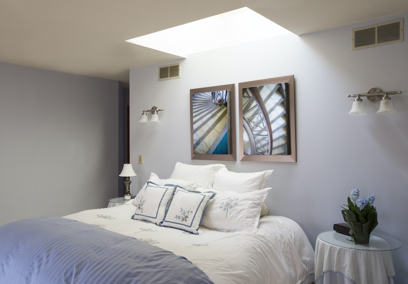 skylight over bed in bedroom