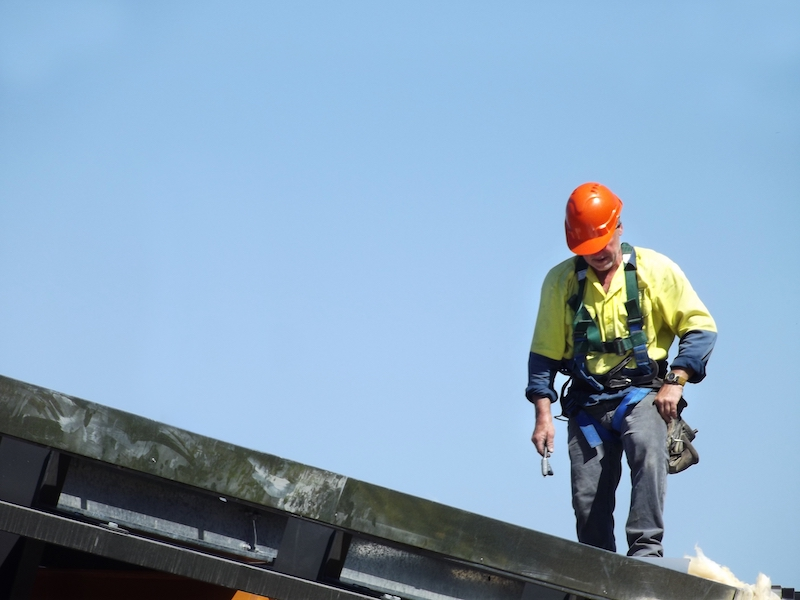 Roofer on Roof in Safety Gear